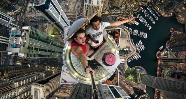 فيديو: مصور (مجنون) في دبي .. يصعد لقمة الابراج ويصور سيلفي بكل استهتار